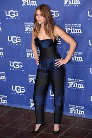 Jennifer Lawrence paired her strapless jumpsuit with black satin Casadei pumps.