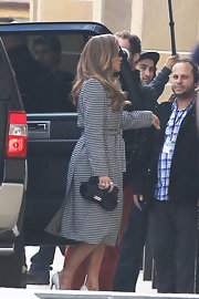 Jennifer Lopez looked extra ladylike in a sophisticated black-and-white houndstooth trench.