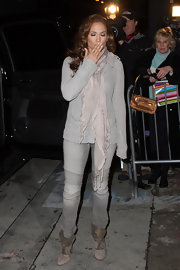 "Jennifer rocked a pair of ""Biker Zip Bottom"" skinny jeans in gray. Stars are loving these jeans with stitched knee detailing."