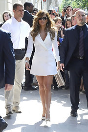 Jennifer was all business leaving her hotel in Paris wearing a white coat dress and matching high heels.