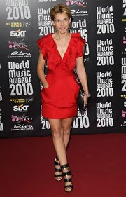 Clotide rocked out her crimson, ruffled cocktail dress with an edgy, gold chain-embellished sandals.