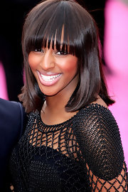 "Singing sensation Alexandra Burke showed off her darling blunt cut bangs and shoulder length bob while attending the UK premiere of ""The Back-Up Plan""."