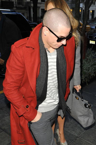 Casper Smart's red wool coat added a pop of color to his layered look.
