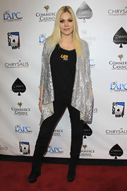 Shanna Moakler paired her black skinny jeans with matching suede knee high wedge boots.