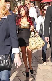 Nicole Polizzi added spice to her revealing look with a studded tote.