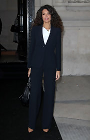 Afef Jnifen looked elegant in a black pantsuit at the Giorgio Armani Prive fashion show during Paris Haute Couture week.