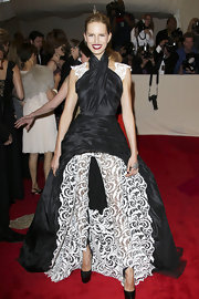 Karolina Kurkova donned dramatic black crocodile Daffodile platforms with her lace halter neck gown at the 2011 Met Gala.