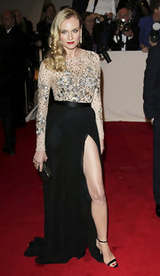 Diane Kruger carried an elegant black and gold Lina hard case clutch to the 2011 Met Gala.