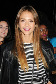 Jessica Alba contrasted her edgy outfit with a feminine berry-hued lip color when she attended the Charlotte Ronson fashion show.