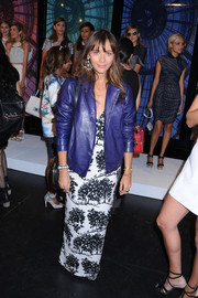 Rashida Jones layered a blue leather jacket over her print maxi dress for a more stylish finish during the Charlotte Ronson fashion show.