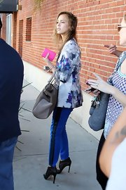 Jessica Alba added some flair to her outfit with her blue skinny jeans by visiting an L.A. salon.