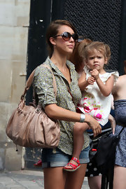 Jessica Alba showed off her blush toned leather shoulder bag while holding daughter Honor on her hip.