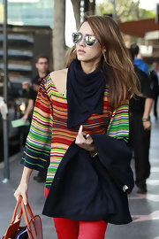 Jessica Alba tempered her colorful outfit with this black scarf.