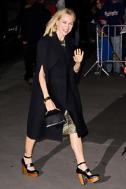 Naomi Watts showed off a hint of her shimmery dress with a short-sleeved black coat.