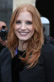 Jessica Chastain opted for a light pink lip to pair with her plum eye shadow for her daytime beauty look.