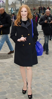 Jessica Chastain looked classic and stylish in a black wool coat with gold buttons at the Louis Vuitton fashion show in Paris.