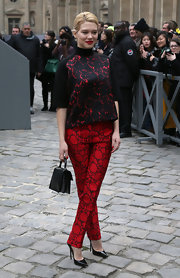 Lea Seydoux rocked a black lace-print turtleneck while attending the Louis Vuitton fashion show in Paris.