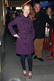 Jessica wore a classic trench in a bright purple hue in New York city.