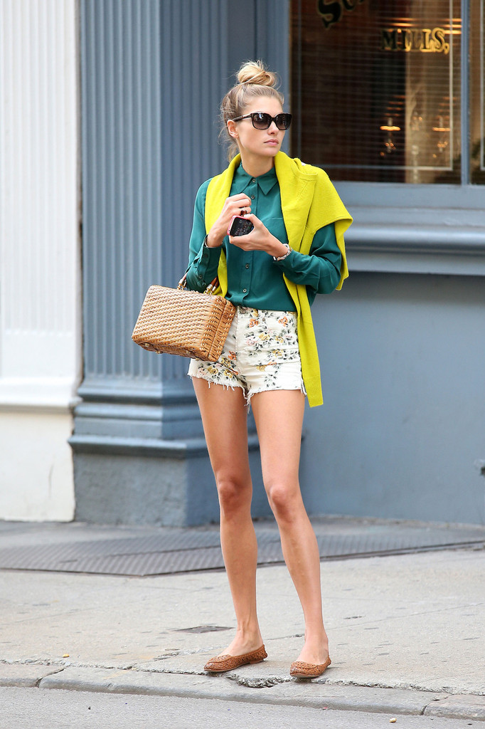 Jessica Hart plays around with her iPhone as she goes out in SoHo in New York City. Hart is an Australian model that has been featured on the cover of Australian Vogue.
