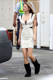AnnaLynne took a break from filming and opted for a cozy pair of sheepskin boots for a more relaxed look and feel.