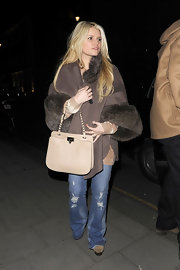 Jessica Simpson added a luxe touch to her street attire with a beige leather Rock Stud purse.