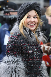 Kylie stays cozy in a wool crochet turban at the Macy's Thanksgiving Day Parade.