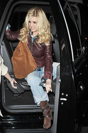 Jessica is all about promoting her products, as she shows off her own suede tote bag and suede strapped boots.