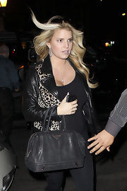 Jessica Simpson slightly obscured her burgeoning bump with a distressed black leather tote.