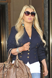 Jessica paired her navy blazer with retro oval glasses while leaving her hotel in NYC.