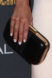 Jessica Szohr complemented her white dress with a stylish black hard-case clutch when she attended the Entertainment Weekly pre-Emmy party.