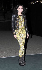 Jessie J layered a leather jacket with flashy gold embellishments over her bold print ensemble.