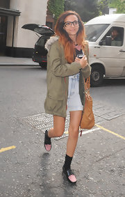Jade wore an army green utility jacket with a furry gray hood while out in London.