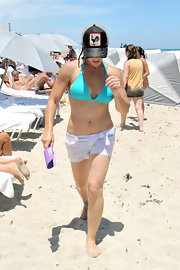 Jillian Michaels covered up her bikini bottom with a pair of white short shorts while enjoying a day at the beach.