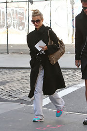 Joanna Krupa may be dressed in sweats, but her wool coat is anything but casual.