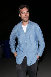 By showing off just a hint of undershirt Joaquin takes his chambray shirt from classic to cool.