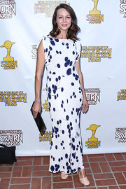 Amy Acker chose a white dress with purple floral prints for her look at the Saturn Awards.