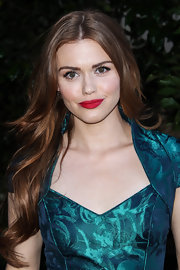 Holland's lips looked full and voluptuous thanks to a bright and bold lipstick.