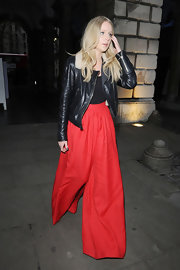 Diana Vickers paired her red parachute pants with a classic black leather bomber jacket.