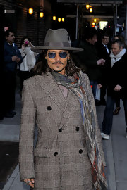 Johnny Depp is known for his affinity for hats like this gray walker hat he donned for 'The Late Show with David Letterman.'