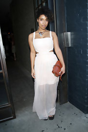 Lianne's flowing white maxi featured a sheer skirt and cutout details on the sides.