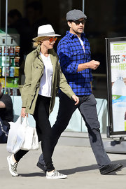Diane Kruger kept her daytime look casual and carefree with this army green utility jacket and jeans.
