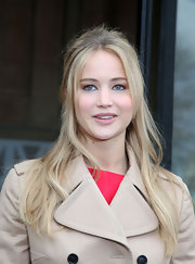 Jenifer Lawrence showed off her long half up hair style at the Miu Miu fashion show.