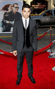 Wilmer Valderrama attended the 'Larry Crowne' premiere wearing a nice suit with a suede vest.