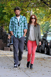 Julianne Moore donned a pair of coral jeans with black ankle boots while strolling around NYC with her husband.