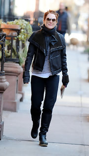 Julianne Moore beat the chill in straight leg jeans tucked into low-heeled leather boots.