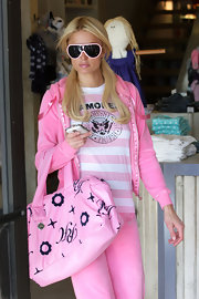Socialite Paris Hilton showed off her love of all things pink with another handbag from her own line. She went all out with a head-to-toe pink look, which looks kind of ridiculous.