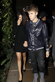 Justin brings out the the letterman jacket trend in a navy style while out with girlfriend, Selena.
