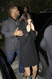Selena wears a black wool coat while out celebrating Justin Bieber's birthday.