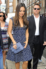 Mila Kunis was perfectly dressed for summer in a sweet polka-dot frock. The printed dress featured a '50s silhouette and feminine hem ruffles.