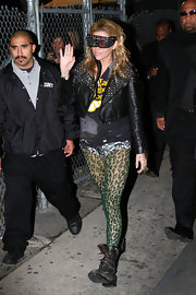 Kesha wears a pair of sheer green leopard print Leo tights to the 'Jimmy Kimmel Live' show. This funky style is available at Tightsplease.co.uk.